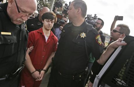 """Ethan Couch is led to a waiting SUV after a juvenile court for a hearing Friday, Feb. 19, 2016, in Fort Worth, Texas. A Texas judge ruled Couch, who used an """"affluenza"""" defense in a fatal drunken-driving wreck will be moved to adult court, meaning the teen could face jail time for the 2013 wreck that killed four people. (AP Photo/LM Otero)"""