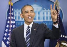 President Barack Obama hold up 2 fingers, in reference to the number of questions he would answer during a news conference on the economy, Friday, Feb. 5, 2016, in the Brady Press Briefing Room of the White House in Washington. (AP Photo/Pablo Martinez Monsivais)