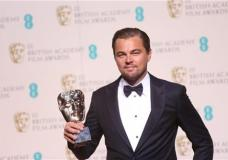 Actor Leonardo Di Caprio with his Best Actor award for his role in the film 'The Revenant' backstage at the BAFTA 2016 film awards at the Royal Opera House in London, Sunday, Feb. 14, 2016. (Photo by Joel Ryan/Invision/AP)
