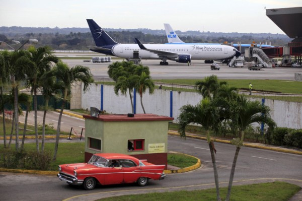 Blue Panorama and KLM aircrafts are seen as a taxi drives out of a parking lot at Havana's Jose Marti International Airport on Feb. 15. Photo: Reuters