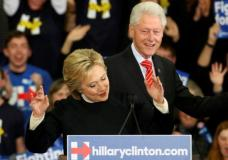 Democratic U.S. presidential candidate Hillary Clinton is accompanied by her husband, former U.S. President Bill Clinton, as she speaks to supporters at her final 2016 New Hampshire presidential primary night rally in Hooksett, New Hampshire February 9, 2016.  REUTERS/Adrees Latif