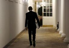 U.S. President Barack Obama carries a binder containing material on potential Supreme Court nominees as he walks towards the residence of the White House in Washington in this February 19, 2016 file photo.  REUTERS/Kevin Lamarque/Files