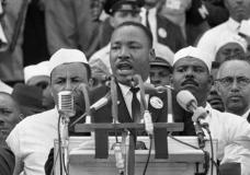 """FILE - In this Aug. 28, 1963, file photo, Dr. Martin Luther King Jr., head of the Southern Christian Leadership Conference, addresses marchers during his """"I Have a Dream"""" speech at the Lincoln Memorial in Washington. As civil rights leaders and activists gather Monday, Jan. 16, 2017, at sites across the country to celebrate the legacy of Martin Luther King Jr., the slain civil rights leader's daughter Bernice King is encouraging Americans to fight for his vision of love and justice """"no matter who is in the White House."""" (AP Photo, File)"""