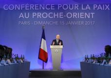 French Minister of Foreign Affairs Jean-Marc Ayrault addresses delegates at the opening of the Mideast peace conference in Paris, Sunday, Jan. 15, 2017. Fearing a new eruption of violence in the Middle East, more than 70 world diplomats gathered in Paris on Sunday to push for renewed peace talks that would lead to a Palestinian state. (Thomas Samson/Pool Photo via AP)