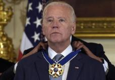 President Barack Obama honors Vice President Joe Biden during a ceremony in the State Dining Room of the White House in Washington, Thursday, Jan. 12, 2017, with the Presidential Medal of Freedom. (AP Photo/Susan Walsh)