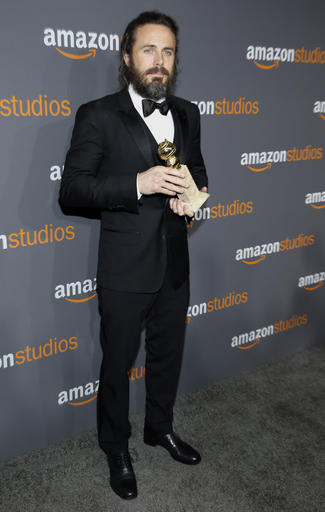 """Casey Affleck, winner of the Golden Globe award for best performance by an actor in a motion picture - drama for """"Manchester by the Sea,"""" arrives at the Amazon Studios Golden Globes after party at the Beverly Hilton Hotel on Sunday, Jan. 8, 2017, in Beverly Hills, Calif. (Photo by Danny Moloshok/Invision/AP)"""