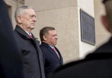 Defense Secretary Jim Mattis stands with Jordan's King Abdullah II bin Al-Hussein during an honor cordon at the Pentagon, Monday, Jan. 30, 2017. (AP Photo/Andrew Harnik)