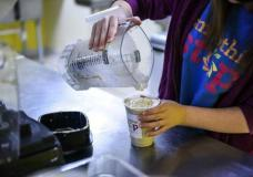 FILE - In this Tuesday, Jan. 10, 2017, file photo, Elizabeth Long, a Smoothie Stop employee, pours a smoothie at the YMCA in Charleston, W. Va. On Wednesday, Feb. 1, 2017, payroll processor ADP reports how many jobs private employers added in January. (Sam Owens/Charleston Gazette-Mail via AP, File)