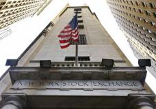FILE - In this Friday, Nov. 13, 2015, file photo, the American flag flies above the Wall Street entrance to the New York Stock Exchange. Stocks are opening modestly lower on Wall Street, Thursday, Feb. 2, 2017, as traders didn't find much to get excited about in the latest batch of earnings reports from U.S. companies. (AP Photo/Richard Drew, File)