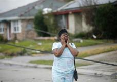 Lisa Carruth reacts as she surveys the damage after a tornado tore through the eastern part of New Orleans, Tuesday, Feb. 7, 2017. The National Weather Service says at least three confirmed tornadoes have touched down, including one inside the New Orleans city limits. Buildings have been damaged and power lines are down. (AP Photo/Gerald Herbert)