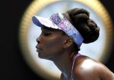 LE - In this Jan. 28, 2017, file photo, United States' Venus Williams makes a forehand return to her sister Serena during the women's singles final at the Australian Open tennis championships in Melbourne, Australia. Doug Adler, a tennis commentator dropped by ESPN for a remark about Venus Williams during the Australian Open has sued the network for wrongful termination. Adler, a former tennis pro, maintains he was describing Williams' aggressive style last month as 'guerrilla' tactics and not comparing her with a 'gorilla.' (AP Photo/Andy Brownbill, File)