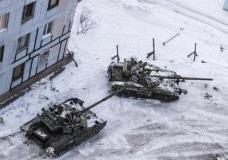 Ukrainian tanks stand in the yard of an apartment block in Avdiivka, eastern Ukraine, Wednesday, Feb. 1, 2017. Heavy fighting around government-held Avdiivka, just north of the rebel-stronghold city of Donetsk, began over the weekend and persisted into early Wednesday. The Contact Group called for the opposing sides to cease fire and urged them to pull back their heavy weapons by the end of the week. (AP Photo/Evgeniy Maloletka)