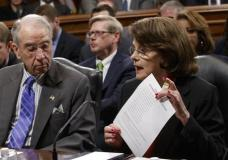 Senate Judiciary Committee Chairman Sen. Charles Grassley, R-Iowa listens as the committee's ranking member Sen. Dianne Feinstein, D-Calif. requests a one week postponement for the panel to vote on Supreme Court nominee Neil Gorsuch, as she displays a list of appointments made during presidential election years, Monday, March 27, 2017, on Capitol Hill in Washington. (AP Photo/J. Scott Applewhite)