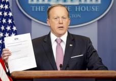 "White House press secretary Sean Spicer holds up a Trump Administration document to ""repeal and replace Obamacare"" as he talks to the media during the daily press briefing at the White House in Washington, Friday, March 10, 2017. (AP Photo/Andrew Harnik)"