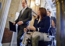 Sen. Pat Toomey, R-Pa., left, and Sen. Tammy Duckworth, D-Ill., arrive at the Senate chamber on Capitol Hill in Washington, Wednesday, March, 15, 2017, for a vote to confirm former Indiana Sen. Dan Coats as director of national intelligence. (AP Photo/J. Scott Applewhite)