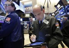 Trader Andrew Silverman, right, works on the floor of the New York Stock Exchange, Wednesday, March 22, 2017. Stocks are treading water in early trading as gains in high-dividend stocks are outweighed by drops in banks and other sectors. (AP Photo/Richard Drew)