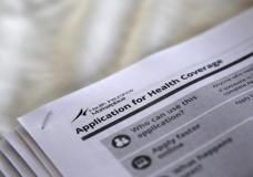 """The federal government forms for applying for health coverage are seen at a rally held by supporters of the Affordable Care Act, widely referred to as """"Obamacare"""", outside the Jackson-Hinds Comprehensive Health Center in Jackson, Mississippi, U.S. on October 4, 2013.  REUTERS/Jonathan Bachman/File Photo"""