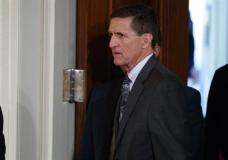 """FILE - In this Feb. 13, 2017 file photo, Mike Flynn arrives for a news conference in the East Room of the White House in Washington. Flynn's attorney says the former national security adviser is in discussions with the House and Senate intelligence committees on receiving immunity from """"unfair prosecution"""" in exchange for questioning. Flynn attorney Robert Kelner says no """"reasonable person"""" with legal counsel would answer questions without assurances. (AP Photo/Evan Vucci, File)"""