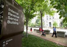In this photo taken Aug. 19, 2015, the Internal Revenue Service Building in Washington. The IRS says it is once again using private debt collectors to go after tax delinquents. The resumption of the program comes amid a wave of telephone scams in which fake IRS agents try to con innocent taxpayers out of their money. (AP Photo/Andrew Harnik)