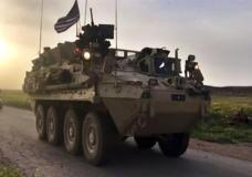 This Friday, April 28, 2017 still taken from video, shows U.S. forces patrolling on a rural road in the village of Darbasiyah, in northern Syria. U.S. armored vehicles are deploying in areas in northern Syria along the tense border with Turkey, a few days after a Turkish airstrike that killed 20 U.S.-backed Kurdish fighters, a Syrian war monitor and Kurdish activists said Friday. (AP Photo via APTV)