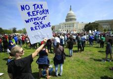 Protesters are gather on Capitol Hill in Washington, Saturday, April 15, 2017, during a Tax Day demonstration calling on President Donald Trump to release his tax returns. (AP Photo/Manuel Balce Ceneta)