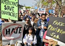 Protesters rally near the Intrepid Air and Sea Museum where President Trump is expected to visit, Thursday May 4, 2017, in New York. (AP Photo/Bebeto Matthews)
