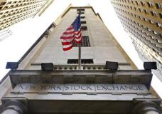 FILE - In this Friday, Nov. 13, 2015, file photo, the American flag flies above the Wall Street entrance to the New York Stock Exchange. European stock markets gave up some recent gains Monday, May 8, 2017, after Emmanuel Macron comfortably won the French presidential election. Over the past couple of weeks, European stocks, particularly French ones, had been buoyant on expectations of a Macron victory over the far-right candidate Marine Le Pen. (AP Photo/Richard Drew, File)