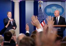 "White House press secretary Sean Spicer, left, calls on a reporter as National Security Adviser H.R. McMaster listens at right during a briefing at the White House in Washington, Tuesday, May 16, 2017. President Donald Trump claimed the authority to share ""facts pertaining to terrorism"" and airline safety with Russia, saying in a pair of tweets he has ""an absolute right"" as president to do so. (AP Photo/Susan Walsh)"