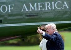 President Donald Trump, accompanied by first lady Melania Trump, gives a thumbs-up as they walk across the South Lawn of the White House in Washington, Friday, May 19, 2017, to board Marine One for a short trip to Andrews Air Force Base, Md. Trump is leaving for his first foreign trip, visiting Saudi Arabia, Israel, Vatican, and a pair of summits in Brussels and Sicily.(AP Photo/Susan Walsh)