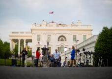 Television network crews begin their evening news broadcast from the driveway outside the West Wing of the White House in Washington, Wednesday, May 17, 2017. The Justice Department has appointed former FBI Director Robert Mueller as a special counsel to oversee a federal investigation into potential coordination between Russia and the Donald Trump campaign to influence the 2016 presidential election.(AP Photo/Pablo Martinez Monsivais)