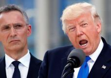 U.S. President Donald Trump (R) speaks beside NATO Secretary General Jens Stoltenberg at the start of the NATO summit at their new headquarters in Brussels, Belgium, May 25, 2017.  REUTERS/Christian Hartmann