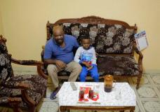 Sudanese activist Tayeb Ibrahim, who had worked to expose Sudanese abuses in the volatile South Kordofan province and hopes to see family living in the U.S. state of Iowa, watches television with his son Mohammed, in Cairo, Egypt, Wednesday, June 28, 2017. Dozens of Sudanese activists living in Egypt as refugees, many of whom fled fundamentalist Islamic militias and were close to approval for resettlement in the United States, now face legal limbo in Egypt after the Supreme Court partially reinstated President Donald Trump's travel ban. (AP Photo/Amr Nabil)
