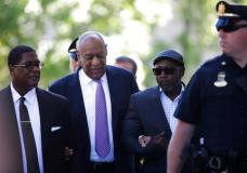 Bill Cosby arrives with Comedian Joe Torry, second from right, for his sexual assault trial at the Montgomery County Courthouse in Norristown, Pa., Friday, June 9, 2017. (AP Photo/Matt Rourke)