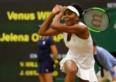 Venus Williams of the United States returns to Latvia's Jelena Ostapenko during their Women's Quarterfinal Singles Match on day eight at the Wimbledon Tennis Championships in London Tuesday, July 11, 2017. (AP Photo/Alastair Grant)