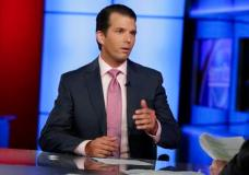 In this photo taken July 11, 2017, Donald Trump Jr. is interviewed by host Sean Hannity on his Fox News Channel television program, in New York. A Russian-American lobbyist says he attended a June 2016 meeting with President Donald Trump's son, marking another shift in the account of a discussion that was billed as part of a Russian government effort to help the Republican's White House campaign.  (AP Photo/Richard Drew)