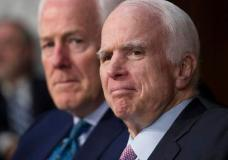 """FILE - In a Tuesday, June 13, 2017 file photo, Sen. John McCain, R-Ariz., right, with Sen. John Cornyn, R-Texas, listens as Attorney General Jeff Sessions testifies on Capitol Hill in Washington. The Philadelphia museum announced Thursday, July 6, 2017, that McCain  has been named this year's recipient of the National Constitution Center's Liberty Medal for his """"lifetime of sacrifice and service"""" to the country. (AP Photo/J. Scott Applewhite, File)"""