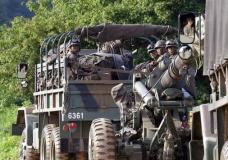 """South Korean army soldiers ride on the back of a truck during an annual exercise in Paju, near the border with North Korea, South Korea, Tuesday, July 4, 2017. North Korea on Tuesday claimed it successfully test-launched its first intercontinental ballistic missile, a potential game-changing development in what may be the world's most dangerous nuclear standoff and, if true, a direct rebuke to U.S. President Donald Trump's earlier declaration that such a test """"won't happen!"""" (AP Photo/Ahn Young-joon)"""