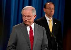 Deputy Attorney General Rod Rosenstein watches at right as Attorney General Jeff Sessions steps away from the podium during a news conference at the Justice Department in Washington, Friday, Aug. 4, 2017, on leaks of classified material threatening national security. (AP Andrew Harnik)