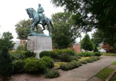 In this photo taken Aug. 14, 2017, the statue of Confederate General Robert E. Lee still stands in Lee park in Charlottesville, Va. Weeks before a statue of Robert E. Lee in Charlottesville, Virginia, became a flashpoint in the nation's struggle over race and history, it already was a focus of emotional debate in the state's Republican primary election.  (AP Photo/Steve Helber)