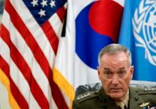 """Joint Chiefs Chairman Gen. Joseph Dunford speaks at a news conference at U.S. Army Garrison Yongsan, Seoul, South Korea, Monday, Aug. 14, 2017.   The top U.S. military officer is warning during a trip to Seoul that the United States is ready to use the """"full range"""" of its military capabilities to defend itself and its allies from North Korea. A spokesman says Marine Corps Gen. Dunford also told his South Korean counterparts Monday that the North's missiles and nukes threaten the world. (AP Photo/Andrew Harnik)"""