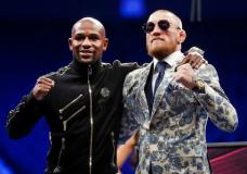 Floyd Mayweather Jr., left, and Conor McGregor pose during a news conference after a super welterweight boxing match Sunday, Aug. 27, 2017, in Las Vegas. (AP Photo/Isaac Brekken)