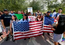 DACA supporters march to the Immigration and Customs Enforcement office to protest shortly after U.S. Attorney General Jeff Sessions' announcement that the Deferred Action for Childhood Arrivals (DACA), will be suspended with a six-month delay, Tuesday, Sept. 5, 2017, in Phoenix. President Donald Trump on Tuesday began dismantling the Deferred Action for Childhood Arrivals, or DACA, program, the government program protecting hundreds of thousands of young immigrants who were brought into the country illegally as children. (AP Photo/Matt York)