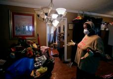 Lois Rose looks over belongings while salvaging items from her flood-damaged house Thursday, Aug. 31, 2017, in Houston. The city continues to recover from record flooding caused by Hurricane Harvey. (AP Photo/Charlie Riedel)