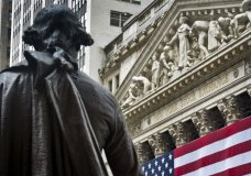 FILE - In this Wednesday, July 8, 2015, file photo, Federal Hall's George Washington statue stands near the flag-covered pillars of the New York Stock Exchange. U.S. stocks are off to a mixed start on Wall Street, Friday, Sept. 29, 2017, as gains in big technology companies are partly offset by losses in energy and industrial stocks. Chipmaker Nvidia and business software maker Oracle both rose. (AP Photo/Bebeto Matthews, File)