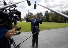 President Donald Trump talks to reporters as he walks to board Marine One on the South Lawn of the White House, Wednesday, Sept. 27, 2017, in Washington. (AP Photo/Evan Vucci)