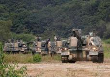 """South Korean army's K-9 self-propelled howitzers move during a military exercise in Paju, South Korea, near the border with North Korea, Monday, Sept. 4, 2017. Following U.S. warnings to North Korea of a """"massive military response,"""" South Korea's military on Monday fired missiles into the sea to simulate an attack on the North's main nuclear test site a day after Pyongyang detonated its largest ever nuclear test explosion. (AP Photo/Ahn Young-joon)"""