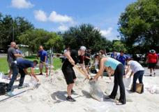 City of Miami volunteers help residents fill free sandbags Thursday, Sept. 7, 2017, in Miami, as residents prepare for Hurricane Irma. A hurricane watch is now in effect for the Florida Keys and parts of South Florida. (AP Photo/Alan Diaz)