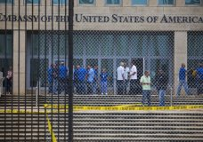 """FILE - In a Friday, Sept. 29, 2017 file photo, staff stand within the United States embassy facility in Havana, Cuba. The terrifying attacks in Cuba overwhelmingly hit U.S. intelligence operatives in Havana, not ordinary diplomats, when they began within days of President Donald Trump's election, The Associated Press has learned. To date, the Trump administration largely described the victims as U.S. Embassy personnel or """"members of the diplomatic community,"""" suggesting it was bona fide diplomats who were hit. That spies, working under diplomatic cover, comprised the majority of the early victims adds an entirely new element of mystery to what's harmed at least 21 Americans over the last year. (AP Photo/Desmond Boylan, File)"""