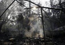Smoke smolders from a wildfire-ravaged home Saturday, Oct. 14, 2017, in Sonoma, Calif. (AP Photo/Marcio Jose Sanchez)