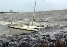 An abandoned boat takes on water on the Mississippi Gulf Coast, Saturday, Oct. 7, 2017, near Biloxi, Miss., as the outer bands of Hurricane Nate begin to batter the shore. (Justin Vicory/The Clarion-Ledger via AP)